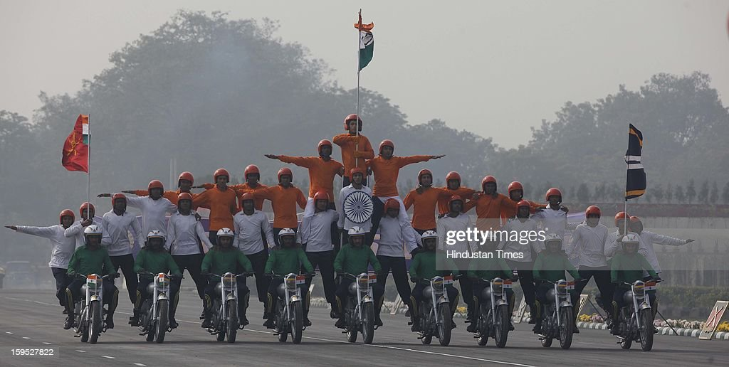 Indian Army soldiers display their skills on motor cycles during the Army Day parade At Delhi cant on January 15, 2013 in New Delhi, India. The 65th anniversary of the formation of the Indian national army was celebrated with soldiers from various regiments and artillery units taking part in a parade.