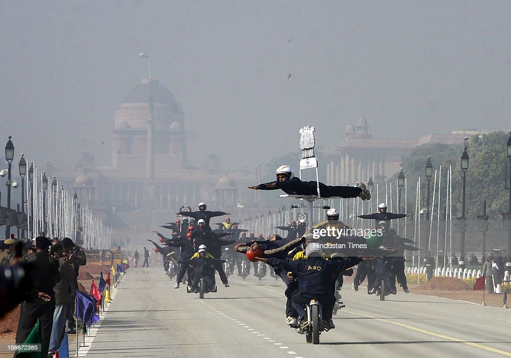 Indian Army soldiers display their skills on the motorcycle during rehearsal for the Republic Day parade 2013 at Rajpath on January 21, 2013 in New Delhi, India.