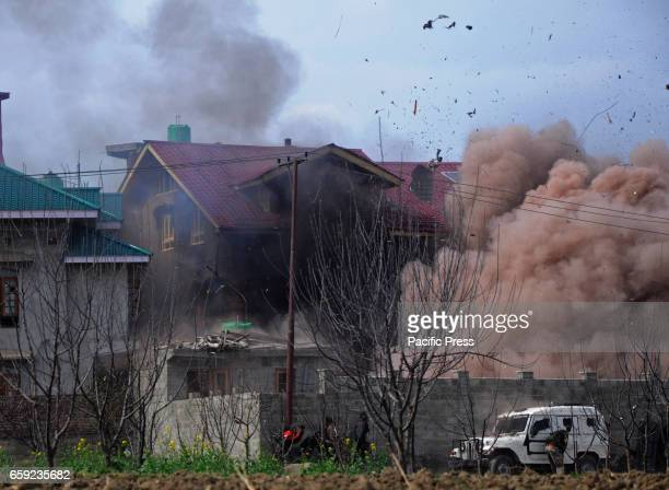 Indian army soldiers explode a residential house during the encounter at Chadoora in Bdugam district One militant and three civilians were killed...