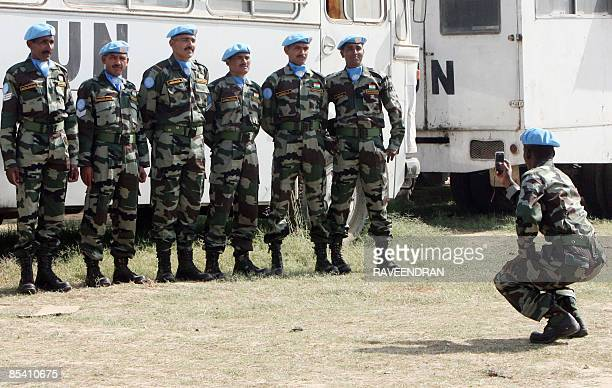 Indian army soldiers gather for a photograph at a farewell function ahead of their departure to Sudan on a United Nations Peacekeeping mission in New...