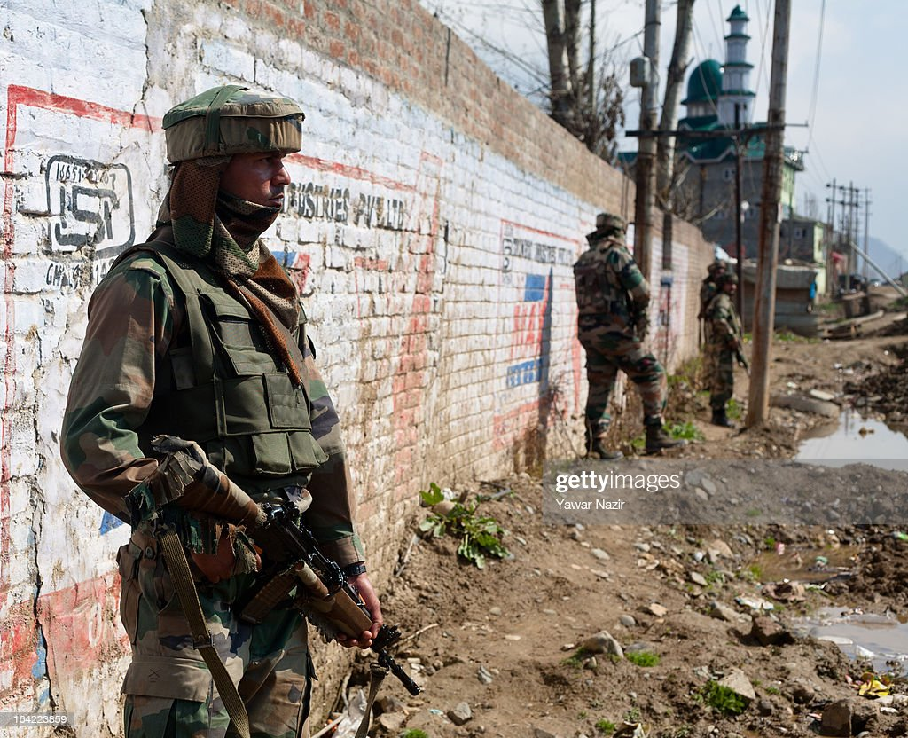 Indian army soldiers guard the area after their vehicle was attacked by suspected militants this early morning on March 21, 2012 in Srinagar the summer capital of Indian administered Kashmir, India. One Indian Border Security Force (BSF) soldier was killed and two others wounded when suspected militants attacked their vehicle on a highway in the outskirts of Srinagar. The attack is the second in the last ten days after a suicide attack by militants left five Indian paramilitary soldiers dead in one of the deadliest attack's in the last five years. The Kashmir valley is on alert since the hanging of Afzal Guru, a local who was convicted of carrying out a deadly attack on the Indian Parliament attack in 2001.