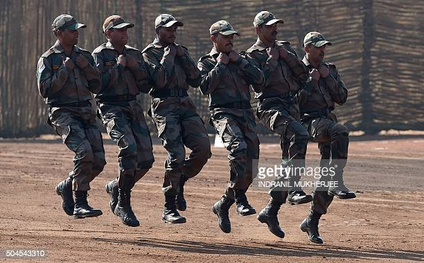 Indian Army soldiers jog back after participating in a firing display during Exercise Sarvatra Prahar at the School of Artillery in Devlali in the...
