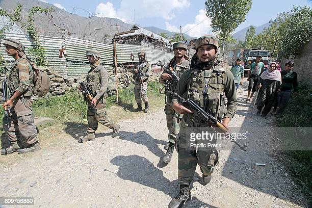 Indian army soldiers leaving the encounter site in Aragam village in north Kashmir's Bandipora some 45 kilometers from Srinagar the summer capital of...