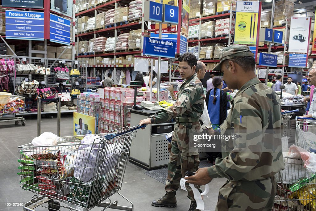 Indian Army soldiers move their shopping carts through a Walmart India Pvt. Best Price Modern Wholesale store in the town of Zirakpur on the outskirts of Chandigarh, Punjab, India, on Tuesday, June 10, 2014. India's consumer price index (CPI) figures and wholesale price inflation figures for May are scheduled for release on June 12 and 16 respectively. Photographer: Udit Kulshrestha/Bloomberg via Getty Images