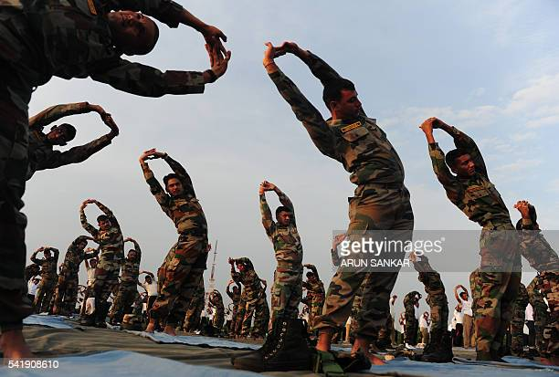 TOPSHOT Indian Army soldiers participate in a yoga demonstration on International Yoga Day in Chennai on June 21 2016 Yoga which means union in...