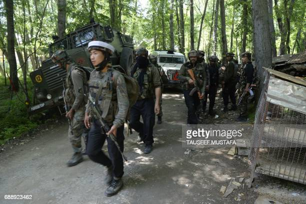 Indian army soldiers patrol after two Kashmiri rebels were killed during a gunfight in the Tral area south of Srinagar on May 27 2017 A top commander...