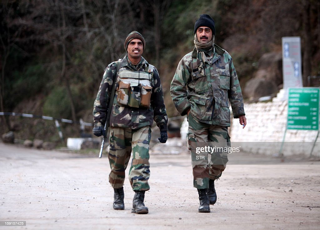Indian Army soldiers patrol in Mendhar village near the Line of Control in the Poonch district of the Indian-administered state of Jammu and Kashmir on January 9, 2013. India summoned Pakistan's envoy in New Delhi Wednesday to protest the killing of two soldiers in a border clash, but warned against any escalation, after apparent tit-for-tat skirmishes that have led to deaths on both sides. AFP PHOTO