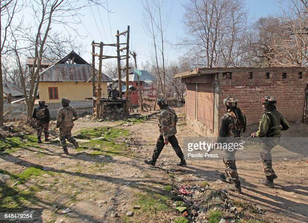 Indian army soldiers patrol near the gun battle site in Hyuna village of Tral some 45 kilometers from Srinagar the summer capital of Indian...