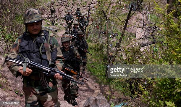 Indian army soldiers patrol the fenced area of Line Of Control on April 20 2015 in Gohalan 120 Kms north west of Srinagar the summer capital of...