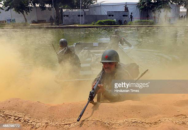 Indian Army soldiers recreate the war scene between India and Pakistan 1965 war a day before the 1965 War Golden Jubilee celebrations at Rajpath on...