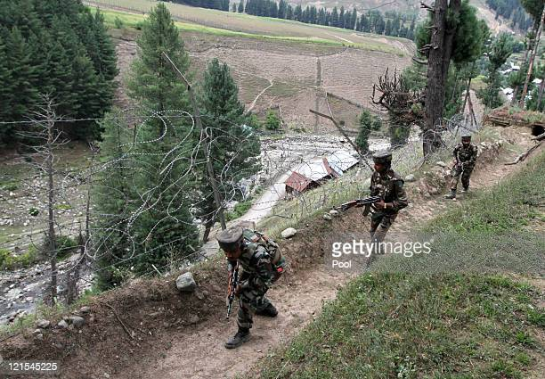 Indian Army soldiers search the area after they killed 12 suspected militants on August 20 2011 in Gurez Kashmir India The Indian Army has claimed to...