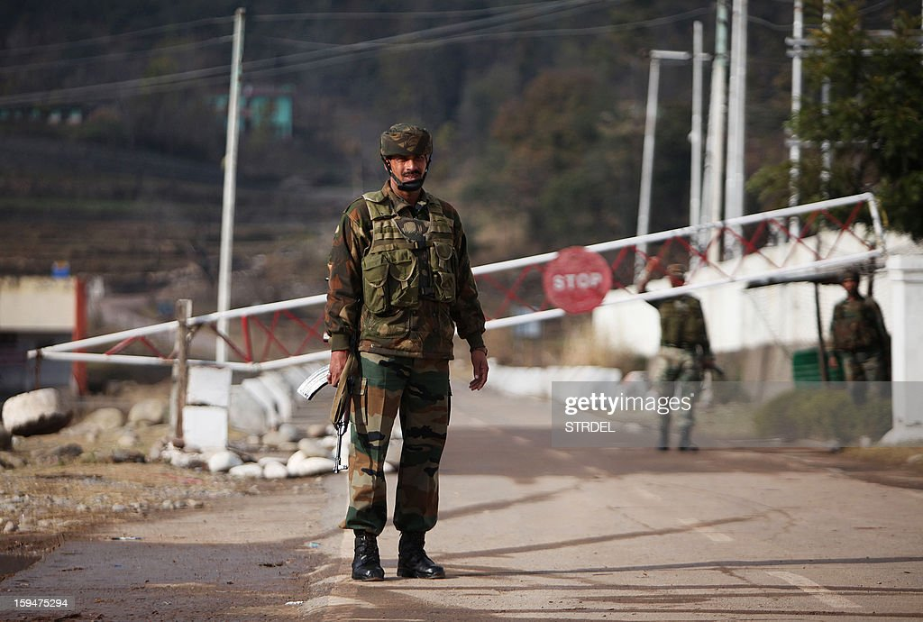 Indian army soldiers stand guard at the Chakan-da-Bagh outpost on the India- Pakistan border near Poonch, about 250 kilometres from Jammu, on January 14, 2013. The Indian army's chief of staff ordered an 'aggressive' response to any cross-border firing by Pakistan as commanders from both sides met to discuss a recent deadly flare-up in disputed Kashmir.