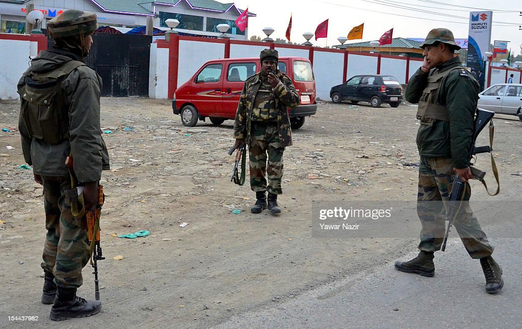 Indian army soldiers stand guard at the scene of a shooting incident outside Hotel Silver Star on October 19, 2012 on the outskirts of Srinagar; the summer capital of Indian administered Kashmir, India. Police reports stated that one person was killed while two were critically wounded when suspected militants opened fire near a hotel on the outskirts of Srinagar city. Lashkar-e-Toiba, a Pakistan based militant group battling Indian rule in Kashmir, has claimed the responsibility for the attack on the hotel in which a bellboy was killed and two other staffers were injured.