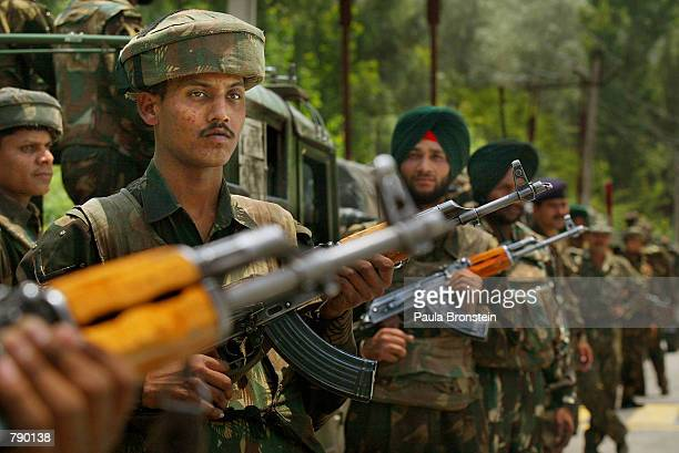 Indian Army soldiers stand guard outside a venue for a conference attended by Indian Defense Minister George Fernandes June 20 2002 in Srinagar the...