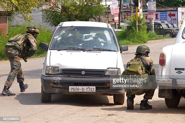 Indian Army soldiers take position during an encounter with armed attackers at the police station in Dinanagar town in the Gurdaspur district of...