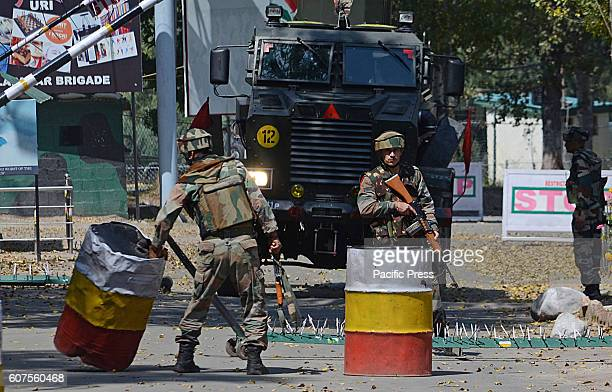 Indian army soldiers take position inside an army base which was attacked by suspected militants in the town of Uri some 100 kilometers from west of...