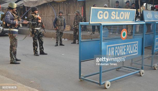 Indian army soldiers take position on the perimeter of an air force base during an operation to 'sanitize' the base following fresh firing and...
