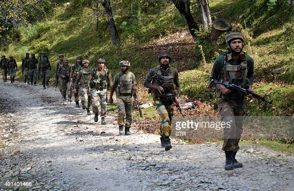 Indian army soldiers take positions at Hafruda forest in Kashmir's Kupwara district around 140 kilometres northwest of the main city of Srinagar...