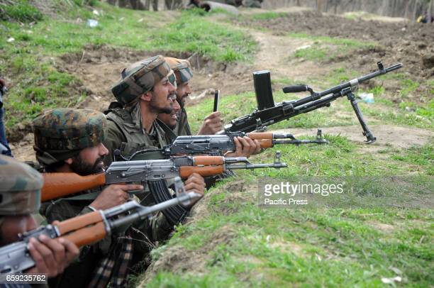Indian army soldiers taking position to fire towards gun battle site in Chadoora area of Central Kashmirs Budgam district One militant and three...