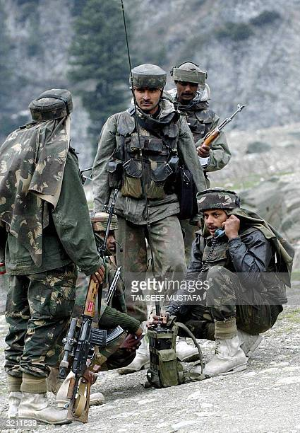 Indian army soldiers use a field radio in Sonamarg 03 April 2004 during an operation to search for the wreckage and missing pilots from two Indian...