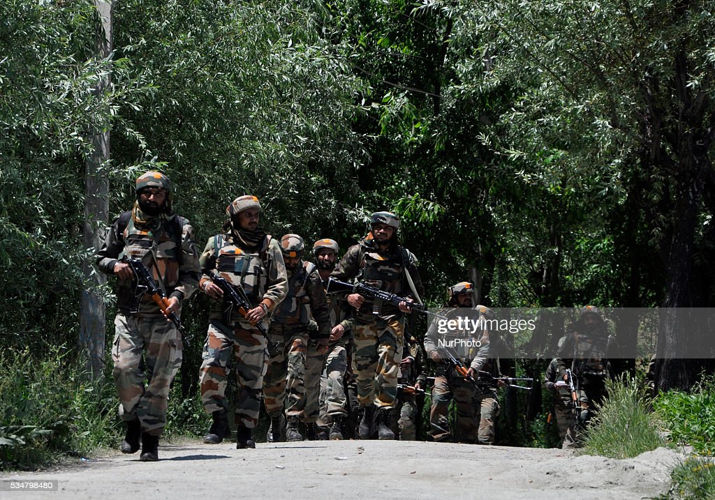 Indian army troopers leave the gunbattle spot after after killing two suspected rebels site in Khonshipora 25 miles west of srinagar on May 27,2016.Two rebels were killed by indian forces during a brief gunfight.