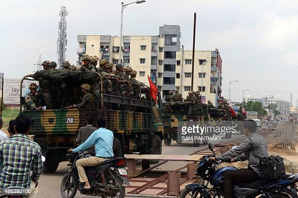 Indian army troops patrol the streets in Ahmedabad on August 27 2015 A court in Gujarat ordered a police inquiry August 27 after at least ten people...