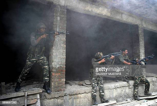 TOPSHOT Indian army troops take position inside a building after a gunfight in Srinagar on August 15 2016 A police paramilitary commander was shot...