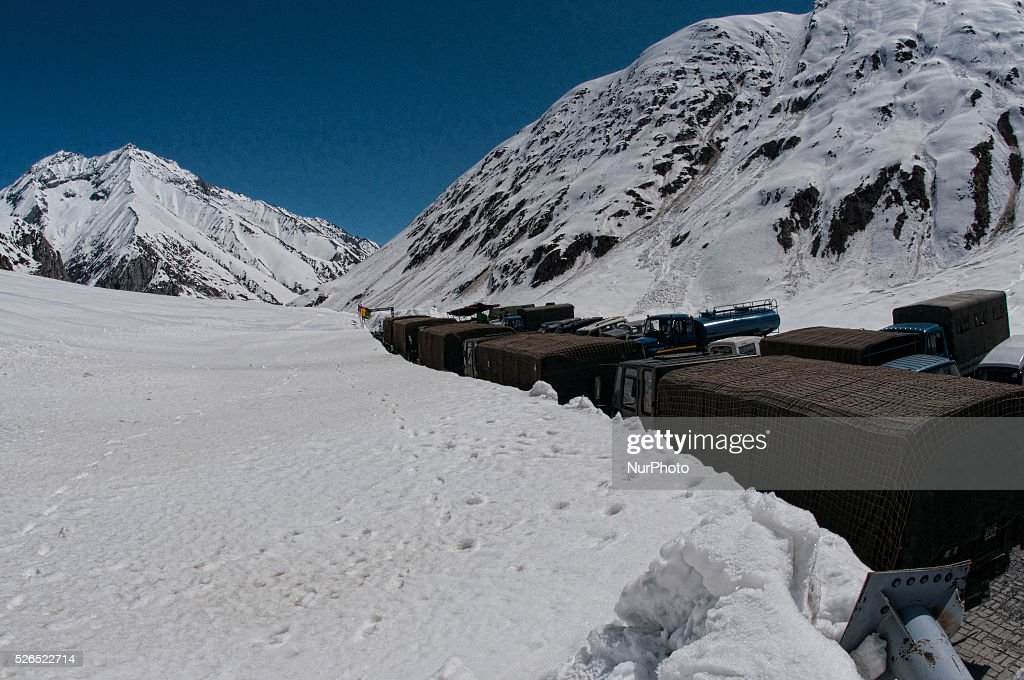 Indian army trucks pass through the snow cleared Srinagar-Leh highway in Zojila, 108 km (67 miles) east of Srinagar, the summer capital of Indian controlled Kashmir, India. on April 30, 2016. The 443 km (275 mile) long highway was opened for the season by Indian Army authorities after the remaining snow at Zojila Pass, some 3,530 metres (11,581 feet) above sea level, had been cleared. The pass connects Kashmir with the Buddhist-dominated Ladakh region, a famous tourist destination known for its monasteries, landscapes and mountains.