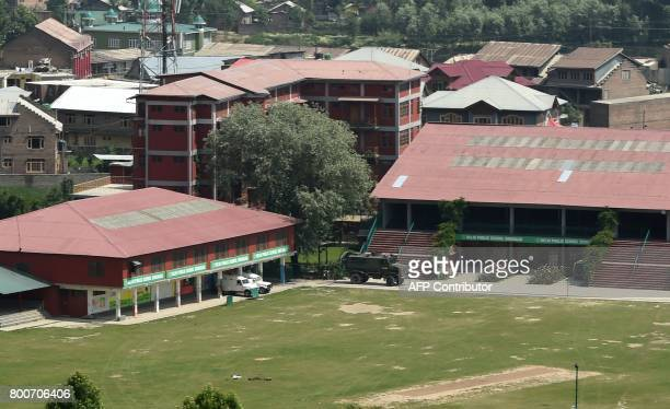 Indian army vehicles are stationed inside the Delhi Public School during a gunfignt with suspected militants and Indian government forces at...