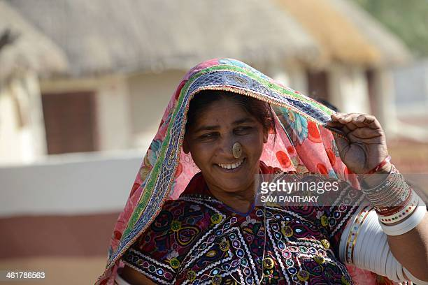 Indian artisan Bayabai Umra wears traditional embroidered dress at Hodka village some 470 kms from Ahmedabad in the Kutch district of eastern Gujarat...