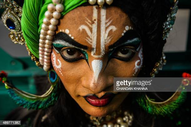 Indian artist Manish Kali dressed as Hindu god Krishna poses as he participates in a religious procession for the Hindu festival Ganesh Chaturthi in...