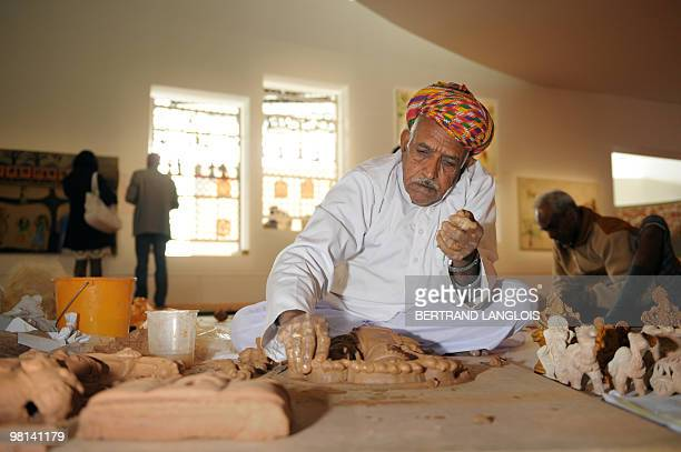 Indian artist Mohanlal makes terracotta figurines on March 30 2010 at the Quai Branly museum in Paris as part of the exhibition 'Others Masters Of...
