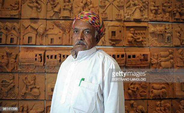 Indian artist Mohanlal poses on March 30 2010 at the Quai Branly museum in Paris as part of the exhibition 'Others Masters Of India' devoted to...