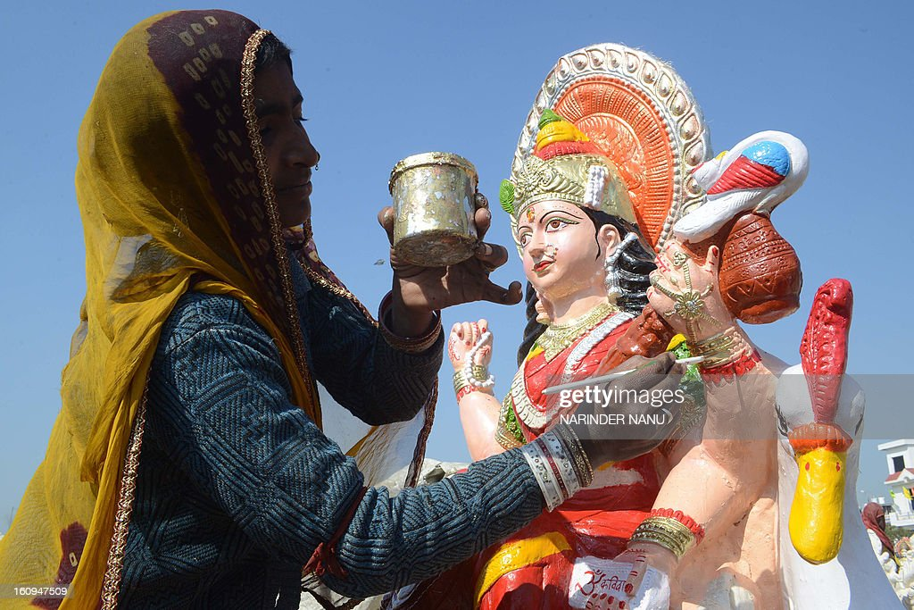 Indian artist Mulee paints an idol of the Hindu goddess Mata Saraswati on the outskirts of Amritsar on February 8, 2013. The idols are in heavy demand ahead of the forthcoming Hindu festival of Basant Panchami which falls this February 14.