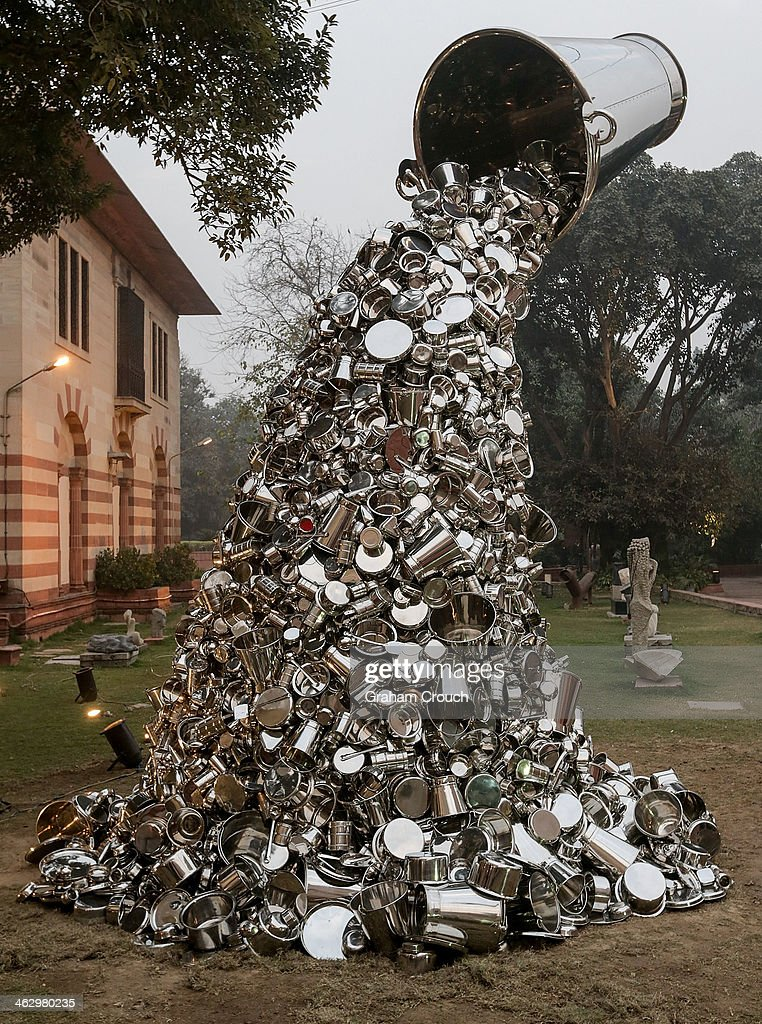Indian artist Subodh Gupta's sculpture 'Ray' that is part of Gupta's first major museum show in New Delhi, 'Everything Is Inside' at National Gallery of Modern Art on January 16, 2014 in New Delhi, India.. The exhibition traces Gupta's career from his upbringing in the rural province of Bihar to his rise to prominence as one of India's foremost contemporary artists.The show draws together his varied body of work including painting sculpture, video and