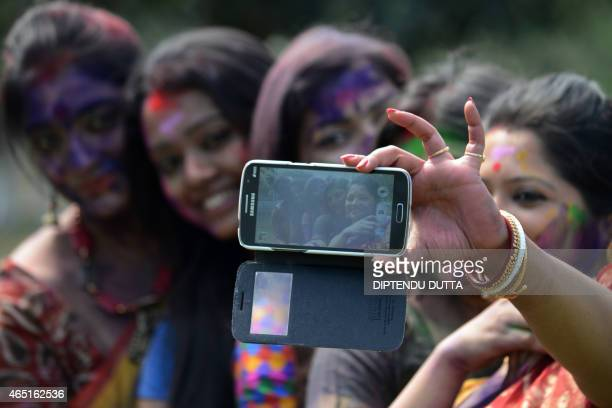 Indian artists covered with coloured powder take a 'selfie' photograph as they rehearse dance for the upcoming Vasantotsav 'the Festival of Spring'...
