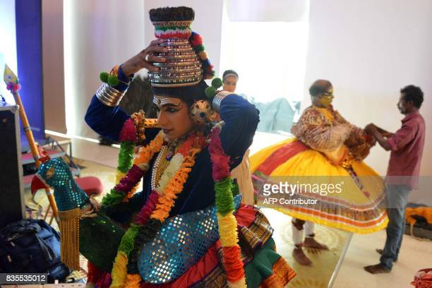 Indian artists from Kerala prepare backstage for a performance during a cultural event to promote Kerala tourism in Amritsar on August 19 2017 / AFP...