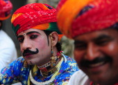Indian artists from Rajasthan state wait for their performance during the Shilp Mela at the North Central Zone Cultural Centre in Allahabad on...