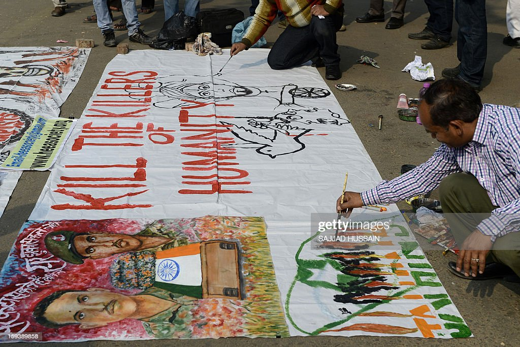 Indian artists prepare a banner at Jantar Mantar as they protest the killing of two Indian soldiers in the disputed Kashmir region, in New Delhi on January 13, 2013. The beheading of an Indian soldier may have sparked a war of words between Delhi and Islamabad but the two nuclear rivals are both determined to prevent it from wrecking a fragile peace process. Two Indian soldiers died after a firefight erupted in disputed Kashmir on Tuesday as a patrol moving in fog discovered Pakistani troops about 500 metres (yards) inside Indian territory, according to the Indian army.