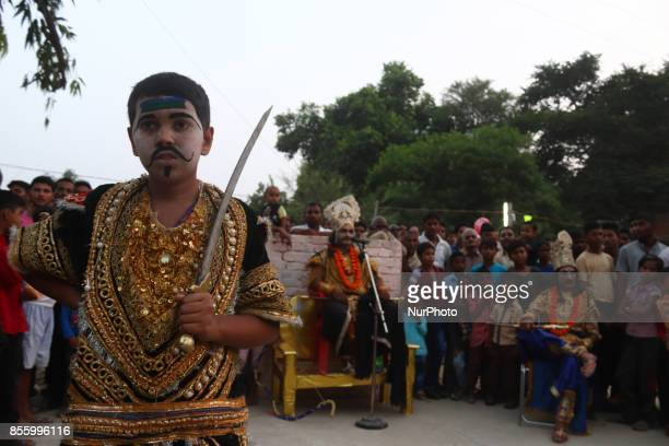 Indian artistsdressed as Demon charactersperform during traditional Ramleelaa play narrating the life of Hindu God Ramon ocassion of Dussehra...