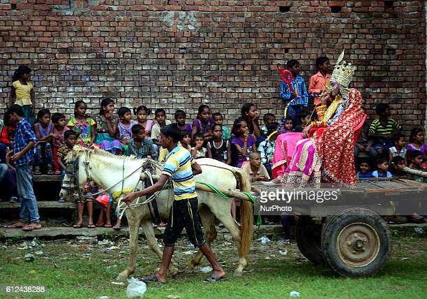 Indian artistsdressed as Hindu Lord Rama and Wife Seeta sit on a horse cart during a traditional Ramleelaa play narrating the life of Hindu God...