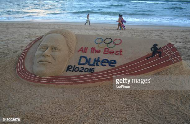 Indian athelet Dutee Chand's sand sclupture looks on the beach of the eastern coast of the Bay of Bengal Sea creating by sand artist Sudarshan...