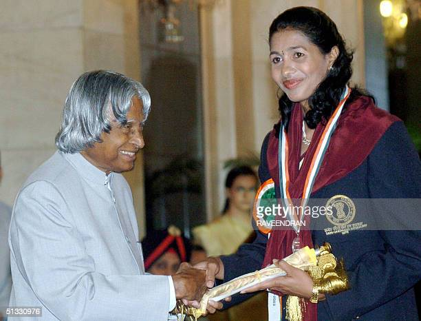 Indian athlete Anju Bobby George winner of a bronze medal in the long jump event at the 2003 World Athletic Championships receives the Rajiv Gandhi...