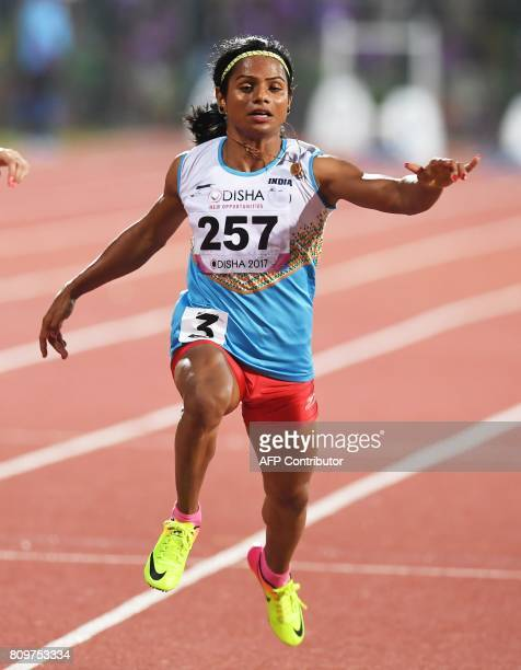 Indian athlete Dutee Chand participates in the womens 100m heat during the first day of the 22nd Asian Athletics Championships at Kalinga Stadium in...
