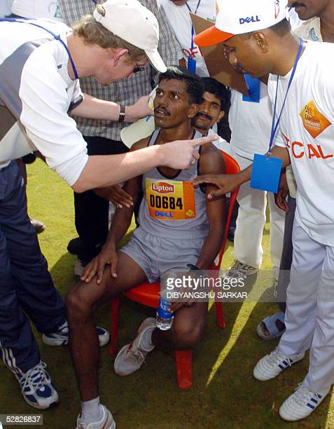 Indian athlete KC Ramu is surrounded by officials after his victory in the first Bangalore International Marathon in Bangalore 15 May 2005 With total...
