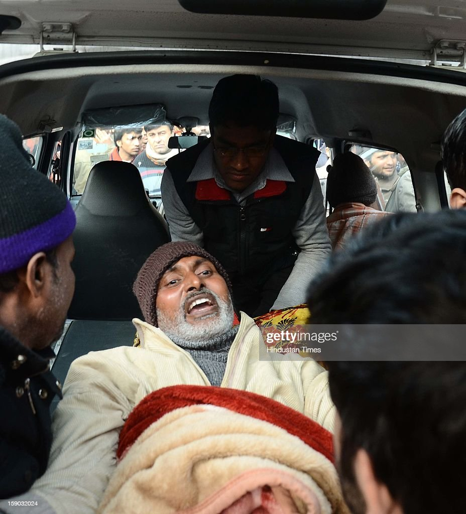 Indian attendants carry Rajesh Gangwal, a protester on hunger strike, to the ambulance after his health was critical from not eating the last thirteen days during a protest against a gang rape at Jantar Mantar on January 6, 2013 in New Delhi, India. Claims of police incompetence and public apathy stirred new anger in the Delhi gang-rape case after the boyfriend of the victim recounted details of the savage attack for the first time. The man was the only witness to the gang-rape of his girlfriend by six men on a moving bus on December 16 which has stirred sometimes violent protests against the treatment of women in Indian society and an apparent rise in sex crime.