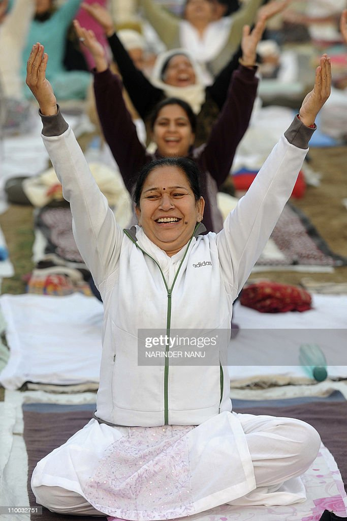 Indian attendees perform yoga exercises during a teaching session organized by Bharatiya Yog Sansthan association in Amritsar on March 13 2011 Yoga...