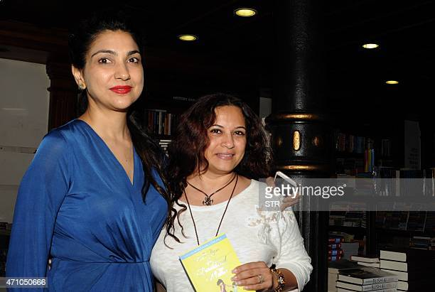 Indian author and mother of two Shunali Khullar Shroff poses with Bollywood actress Mansi Joshi Roy during the launch of her debut book 'Battle Hymn...