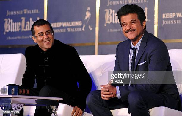 Indian author and screenwriter Chetan Bhagat and Bollywood actor Anil Kapoor speak during a promotional event in Mumbai late August 7 2014 AFP...