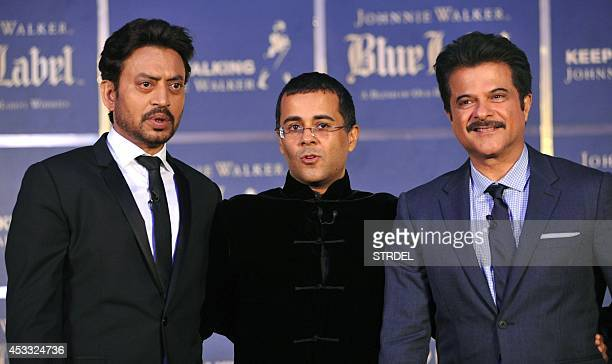 Indian author and screenwriter Chetan Bhagat poses with Bollywood actors Anil Kapoor and Irrfan Khan during a promotional event in Mumbai late August...
